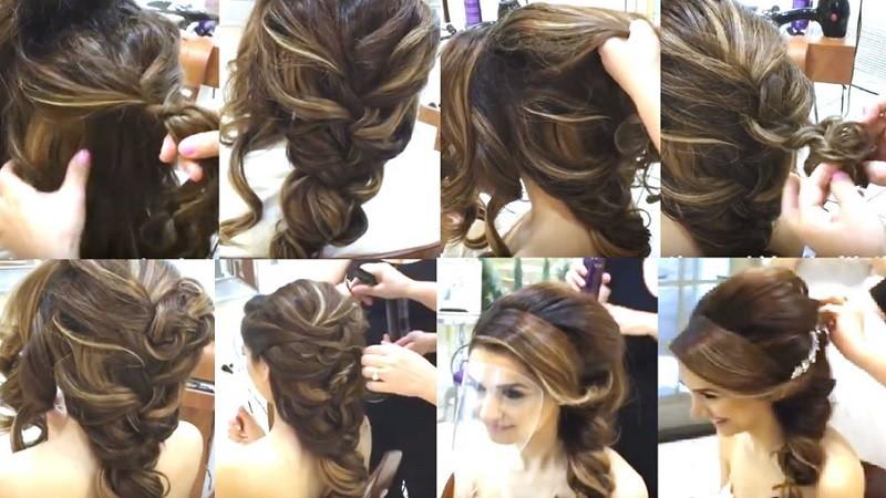 Объёмная коса с использованием накладных прядей, украшенная веткой цветов и фатой поэтапно